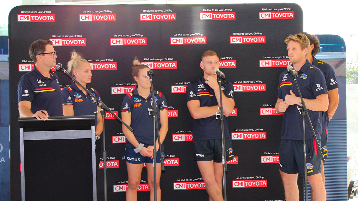 Adelaide Crows players on stage