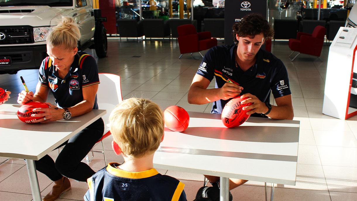 Signing the footballs