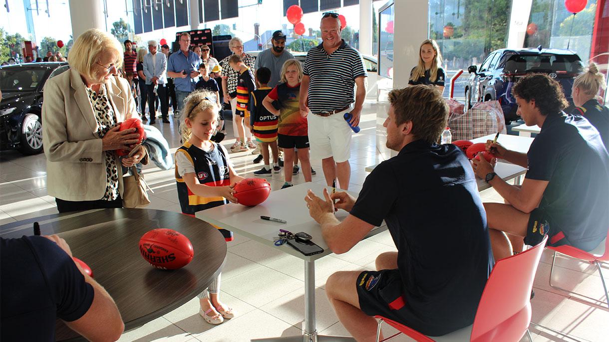 Signing footballs