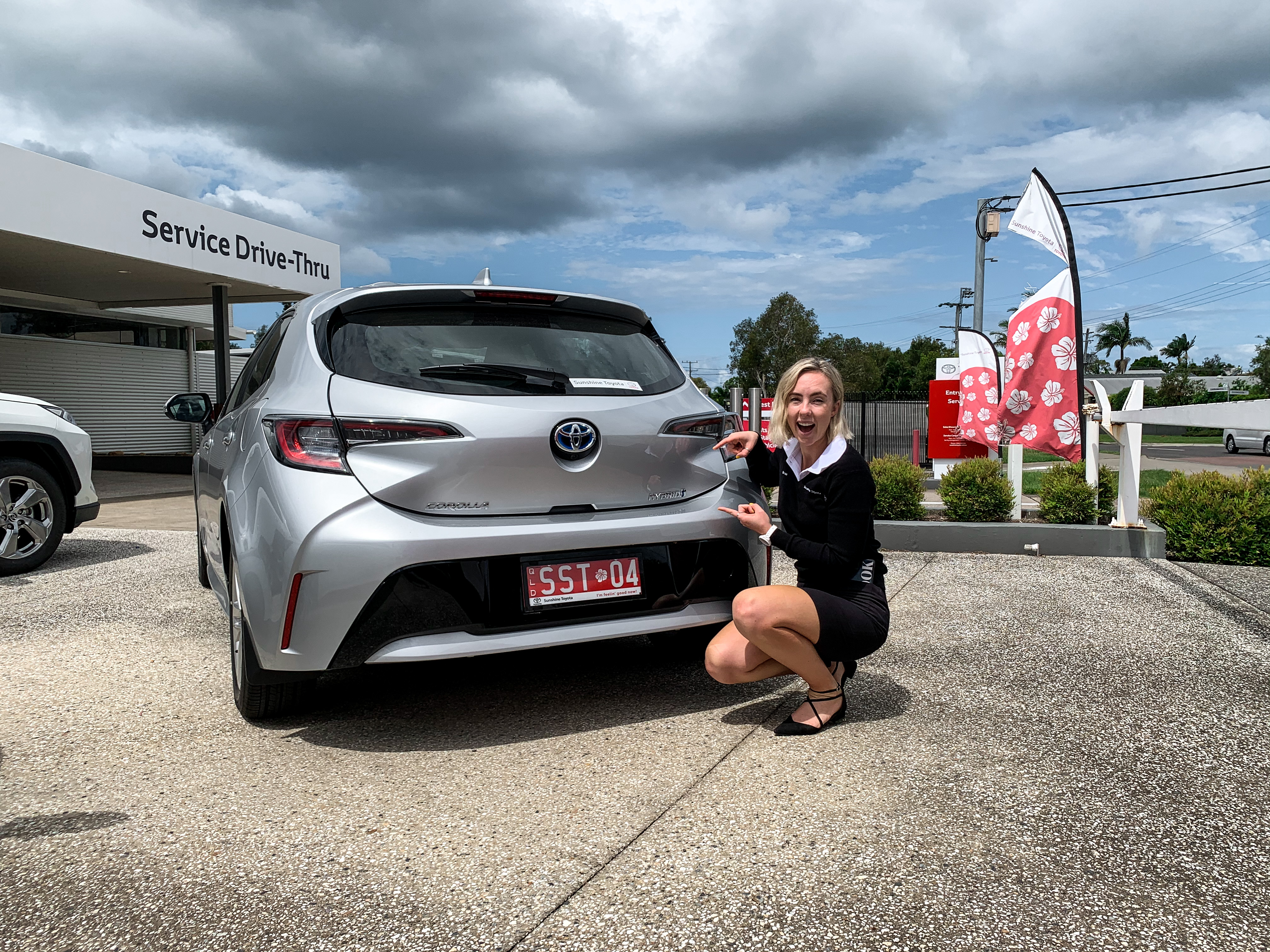Brooke with silver hybrid Toyota Corolla - ask us today at Sunshine Toyota on the Sunshine Coast