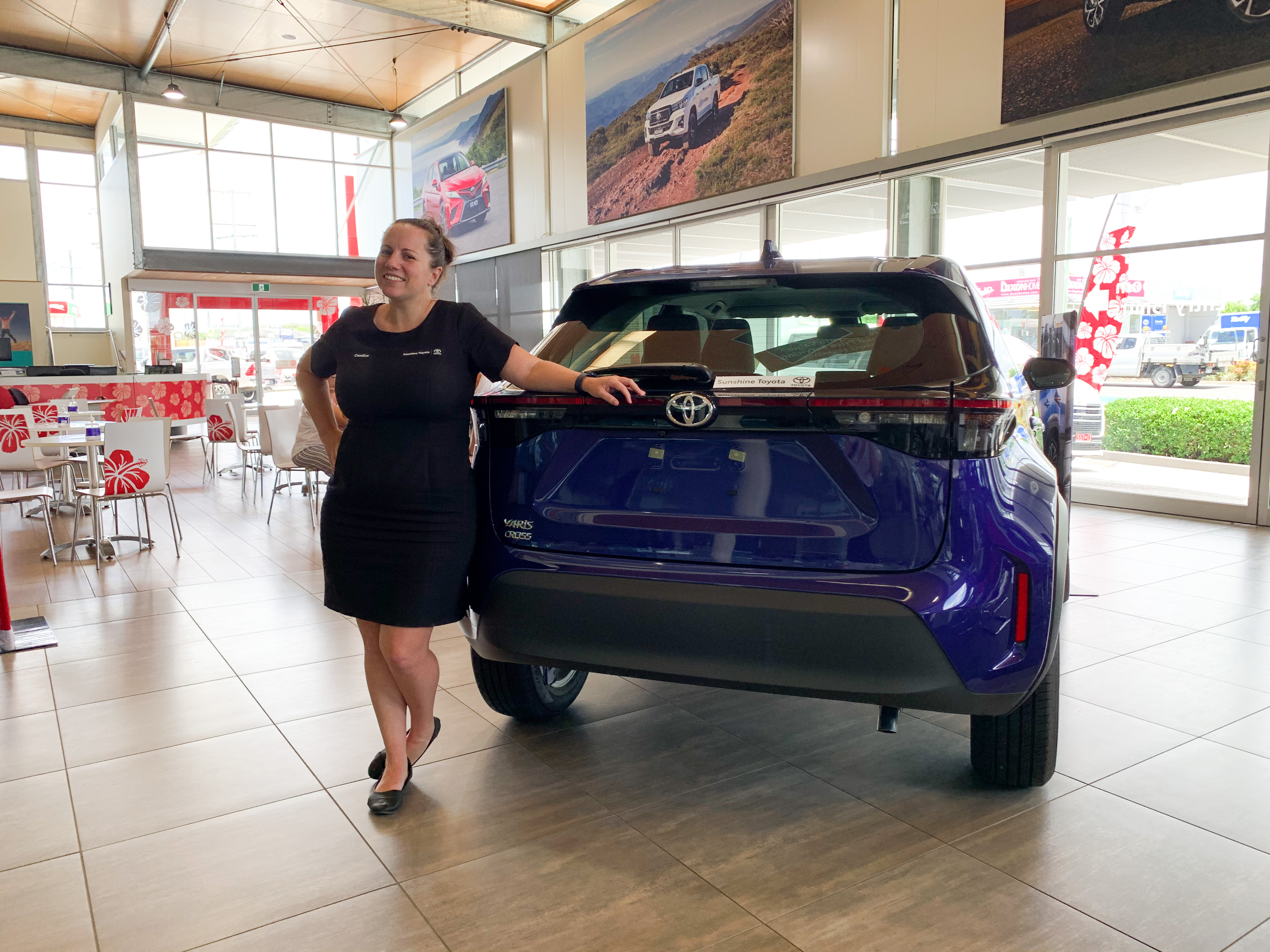 Candice with blue Yaris Cross - ask us today at Sunshine Toyota on the Sunshine Coast